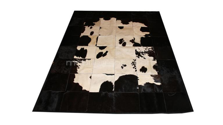 tapis peau de vache noir et blanc maison design. Black Bedroom Furniture Sets. Home Design Ideas